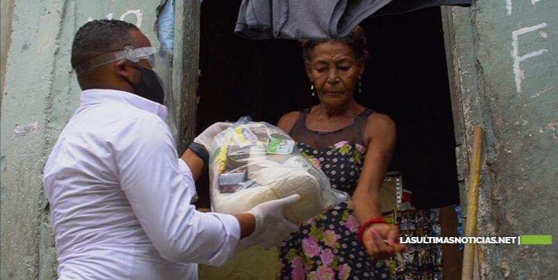 Ejecutorias RD entrega cientos de raciones alimenticias casa por casa en barrios del DN